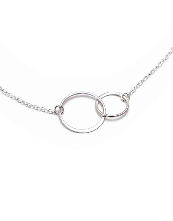 Sterling silver circles connected together and hung on a sterling silver dainty chain. Sweetest necklace to show your love to your mother in law.
