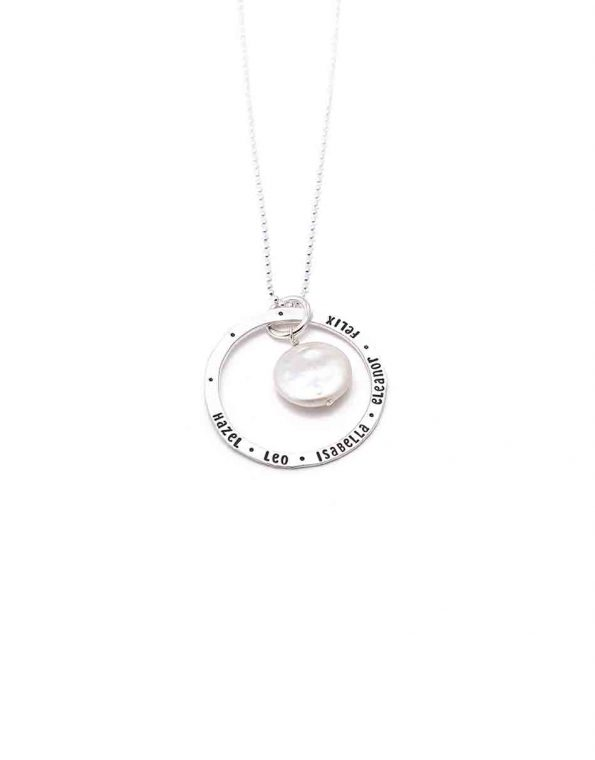 Classic Mother of Pearl necklace with a dainty sterling silver circle, hand stamped with names. Personalized jewelry for a mom