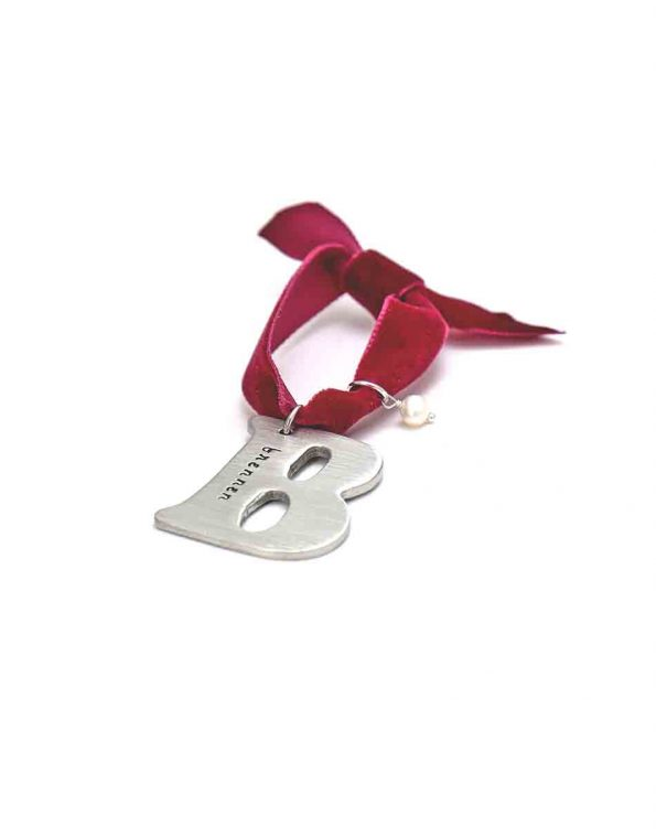 Fine pewter silver letter charm hung in a red velvet ribbon. Hand stamp with name or date. Best gift option for your loved ones