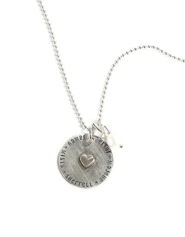 Sterling silver disc, hand-stamped with names, with a dainty sterling silver heart in the middle. Best personalized jewelry gift for wife
