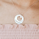Gold-filled layered with a sterling silver circle, hand stamped with names, dates or words. Perfect for moms, grandmoms