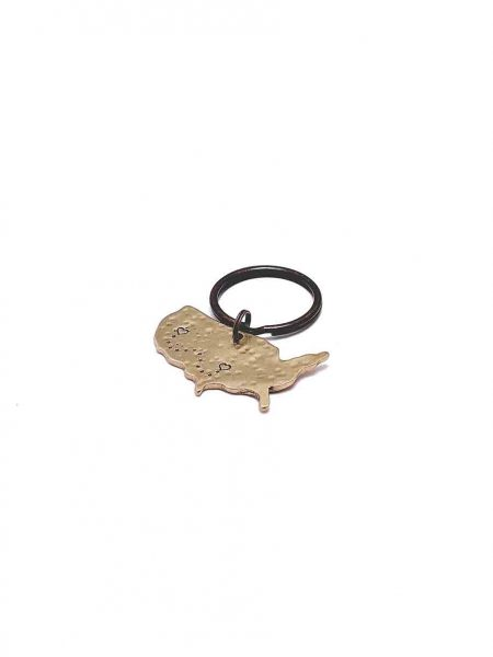 Handsculpted USA charm in a beautiful bronze, handstamped with hearts over any 2 places with dots connecting them.