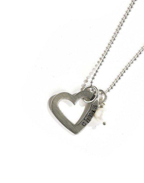 An open heart charm, hand stamped with the name of your loved one. Perfect personalized necklace for fiancée or wife