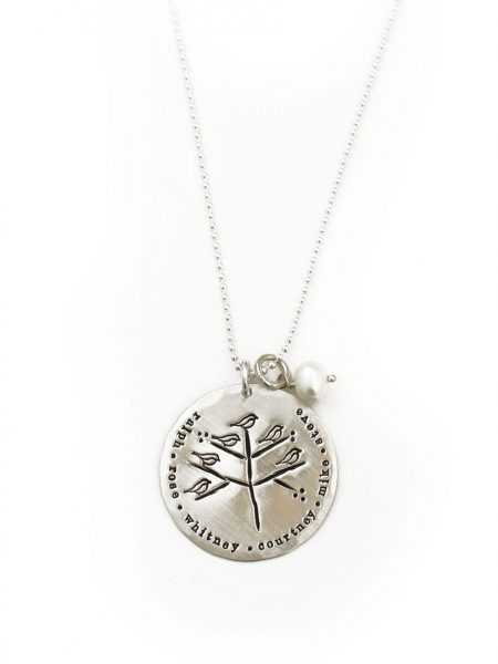A simple tree hand stamped on a large sterling circle with little birdies - kids or family members.