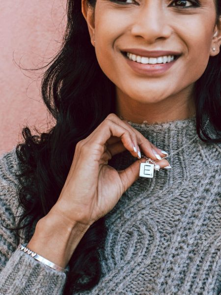 Women wearing Our Family Scrabble Tile Necklace