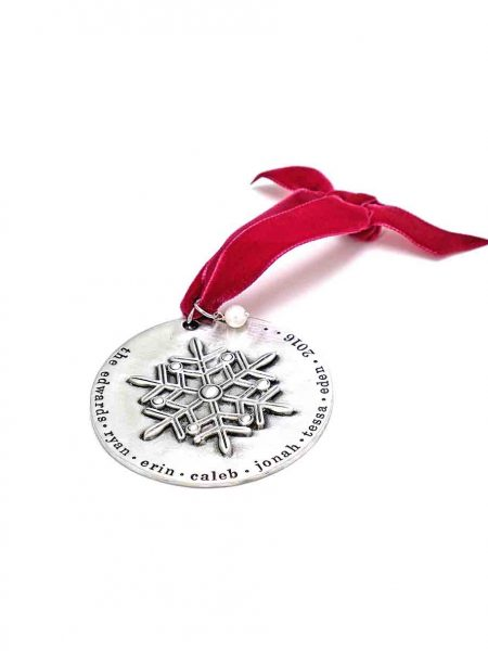A beautiful snowflake ornament, handstamped around the edges with family names. A beautiful keepsake and personalized gift