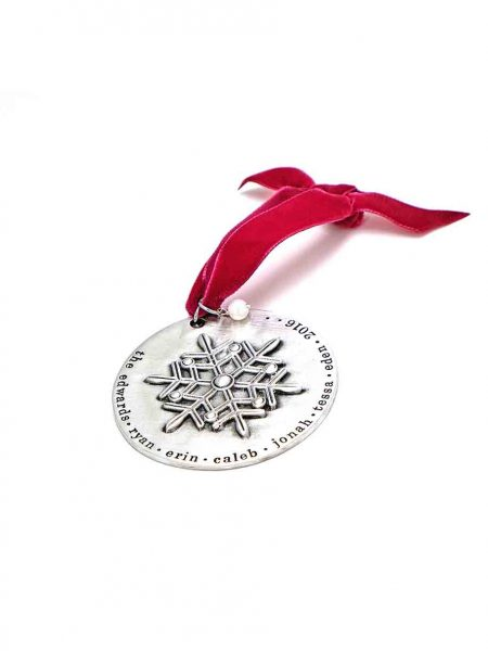 A beautiful snowflake ornament, handstamped around the edges with family names. Perfect personalized family gift