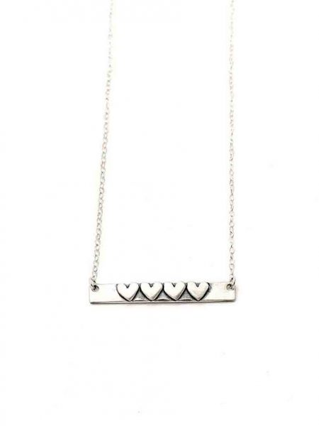 A sterling silver rectangle with hand stamped name on one side and hearts on other side. Personalized necklace for mom
