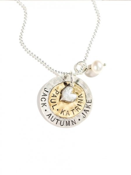 Customized sterling silver disc and the brass disc with names along with a silver heart and a fresh water pearl. Personalized necklace for wife