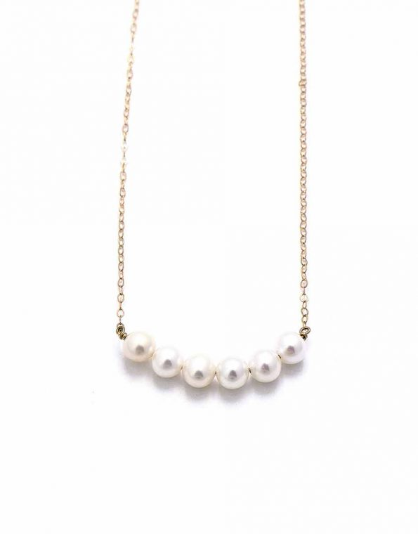 5 freshwater pearls hung together on a goldfilled or a sterling silver chain. Perfect gift for a grandma, mom or wife.