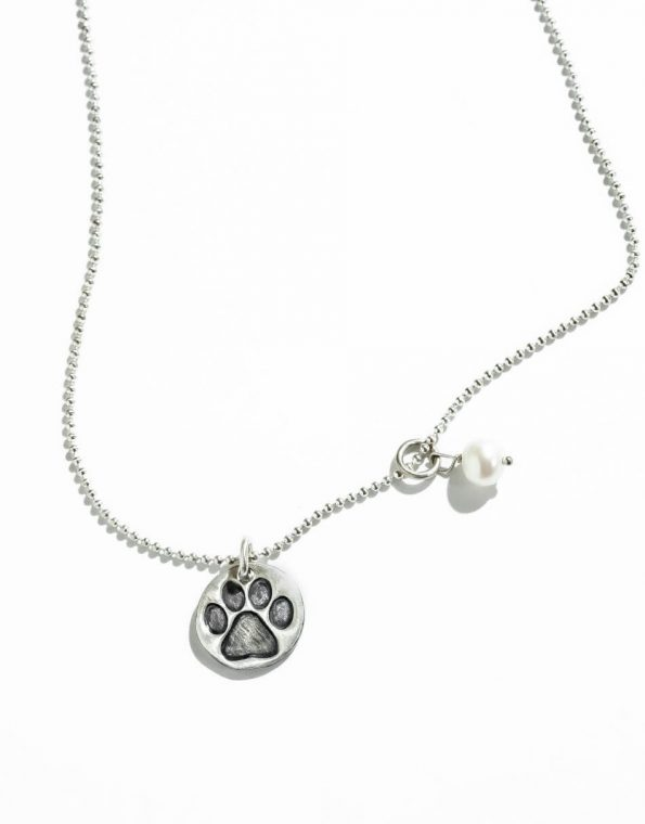 Perfect gift for dog lovers. A sterling silver disc with paw print and a freshwater pearl