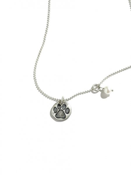 A sweet little paw print in handmade in sterling silver. Perfect gift for dog moms