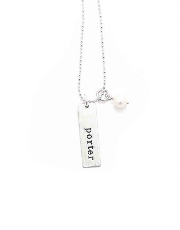 Personalized sterling silver rectangle charm with a freshwater pearl. Perfect name necklace for wife, mom, daughter, sister