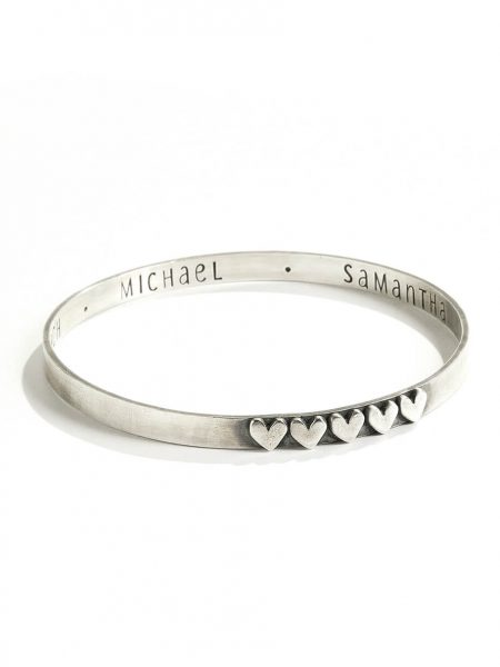 Sterling silver bangle hand stamped on inside with names or a message and hearts on the outside. Personalized bracelet for wife