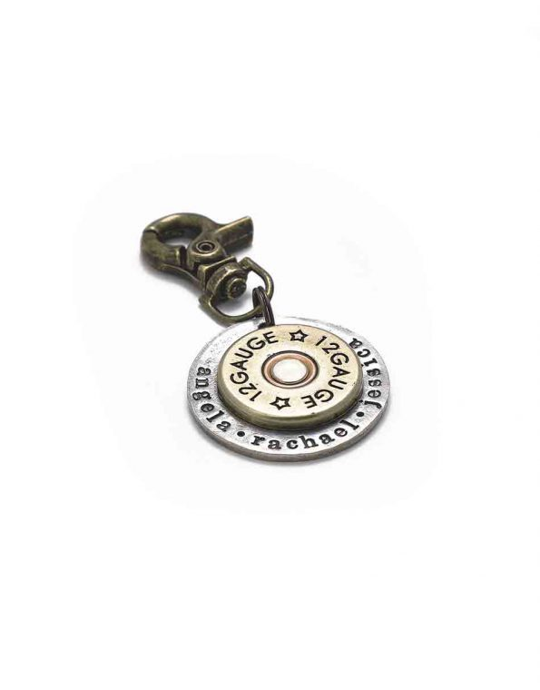 A shotgun shell riveted in the middle of a hand stamped disc. Perfect personalized gift for dad, brother, grandpa