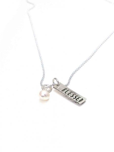 Sterling silver charm with stacked hearts on one side and name hand stamped on the back. Personalized necklace for grandma
