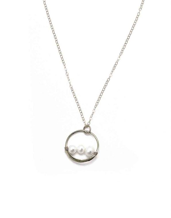A sterling silver or gold-plated circle with freshwater pearls. Beautiful gift for a mom or grandma of 4.