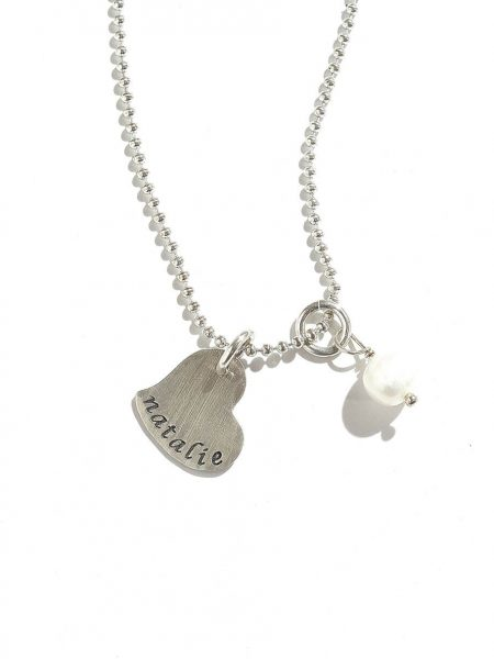 A sterling silver heart charm hand stamped with names or initials. Perfect personalized gift for loved ones