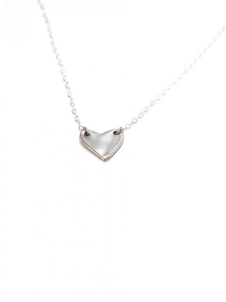 A sterling silver heart hung on a sterling silver dainty chain. Perfect necklace for your wife to tell her how much you love her
