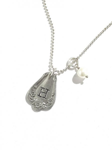 A beautiful charm necklace with hand stamped initial. Perfect personalized jewelry gift for wife, sister, daughter
