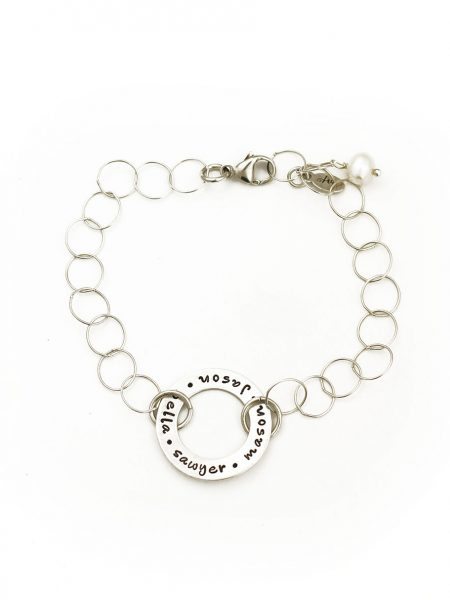 A sterling silver open circle hand stamped with names or message. Perfect gift for family, mom, grandma
