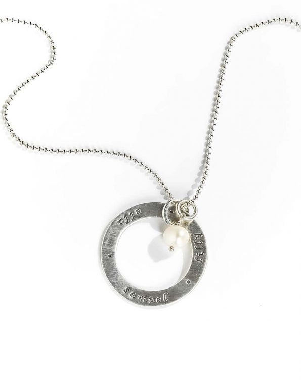 A sterling silver circle of love with a fresh water pearl. Personalize the necklace with names or dates. Best gift for wife, mom