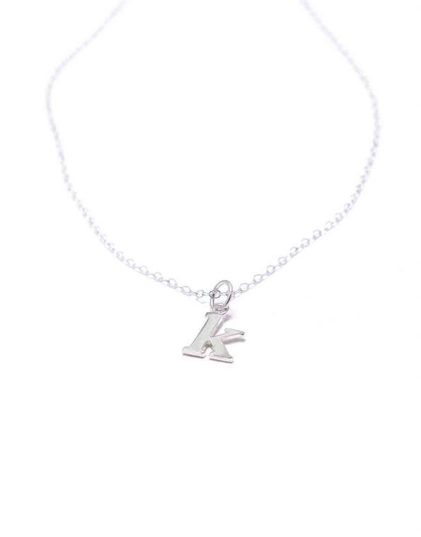 A dainty sterling silver necklace with lowercase typewriter initials. Perfect gift on family occasion or grandma, mom