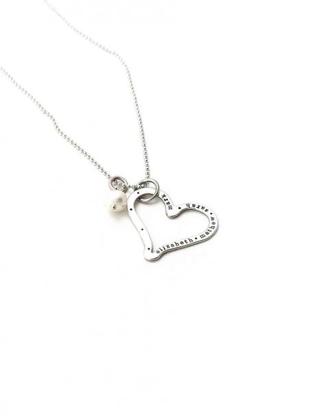 Great personalized heart necklace with hand stamped names. Perfect gift for mom, grandma