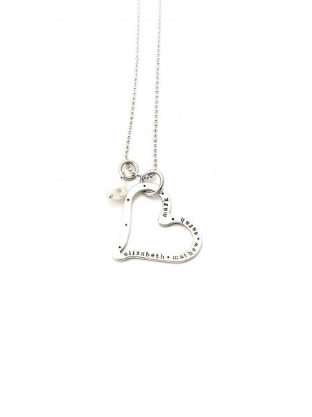 A sterling silver heart with hand stamped names on it. Perfect personalized gift to show your love to wife