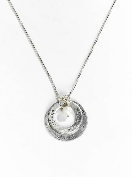 Perfect personalized necklace for a mom. 2 Sterling silver circles of love with hand stamped names of her kids