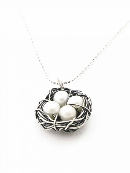 Freshwater pearls messily wrapped in antiqued sterling silver wire. Each egg representing 1 kid. Perfect gift for mom, grandma