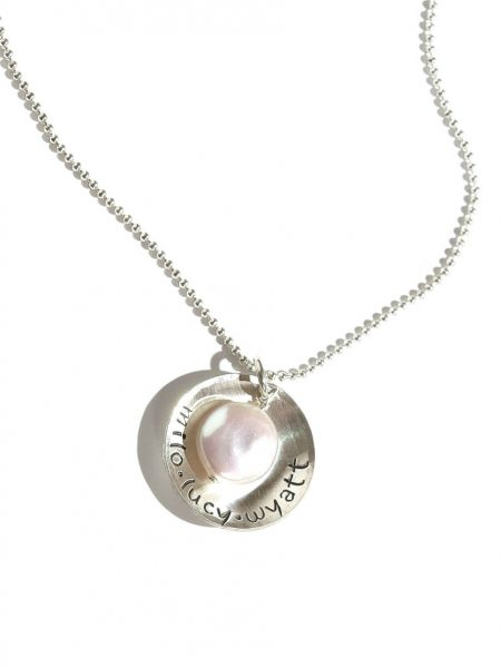 Sterling silver disc charm with mother of pearl in the middle. Personalize with names on it.