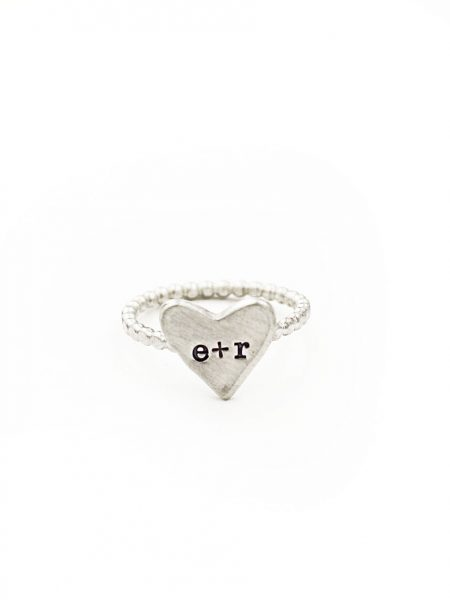 Sterling silver ring with engraved initials of spouse. This is a great gift for couples