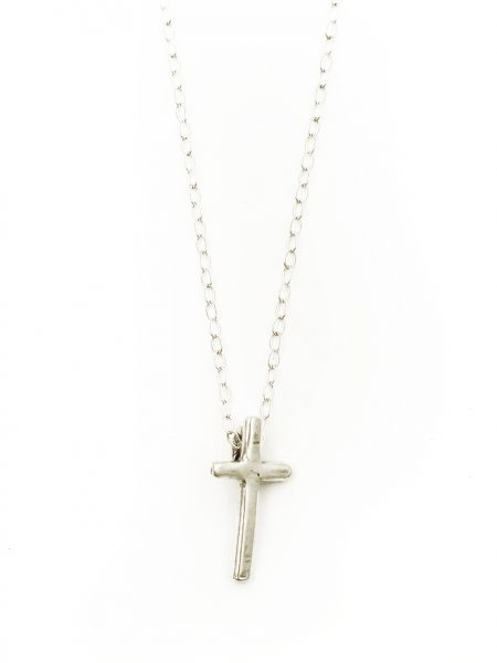 A small hand forged cross charm created with sterling silver and hung on a sterling chain. Perfect for girls of all ages.
