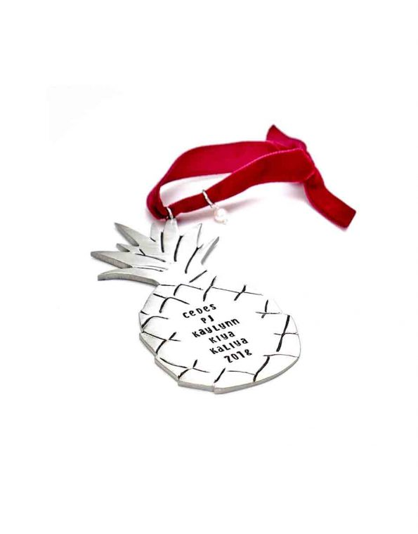 For all the pineapple lovers, hand-stamped with family's name. Cast in fine pewter and finished off with a beautiful red velvet ribbon and a freshwater pearl.