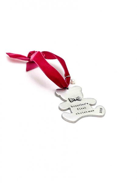 A teddy bear handcrafted and casted in fine pewter. Customize with your kid's name, birthdate, weight.
