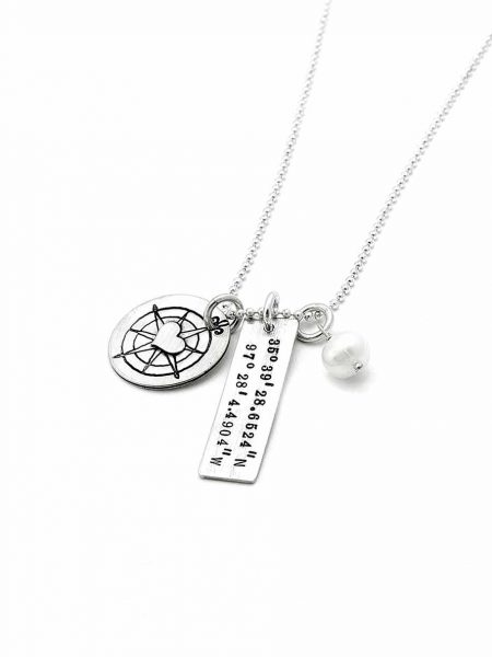 Vintage compass with a sterling heart in the center along with a rectangle charm with the coordinates of your fav place