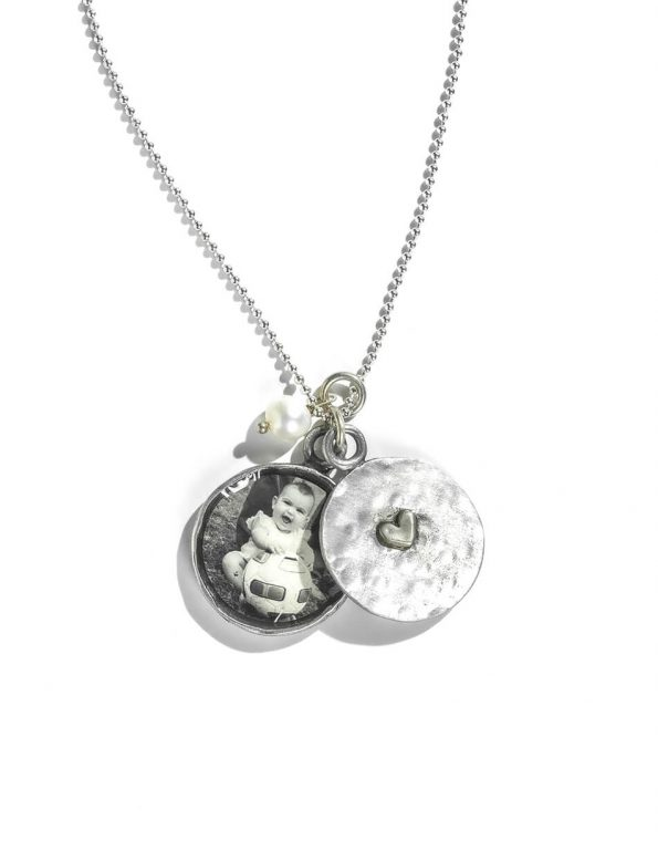 A 2 piece locket, hand stamped on the inside with names or date and the bottom piece has the pick of your little one. Best gift for mom