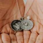 Personalized necklace to gift a mom this mother's day. A locket with the little one's pic and the other part with name hand stamped