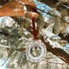 Family wreath ornament is made with quality pewter and topped off with a gorgeous freshwater pearl.