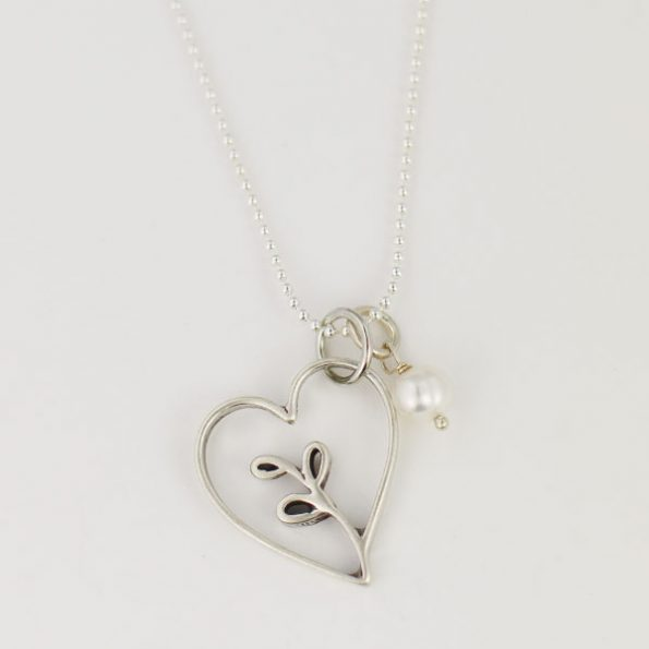 Hand-forged sterling silver heart charm necklace, a stunning gift for parents, parents-to-be or new moms