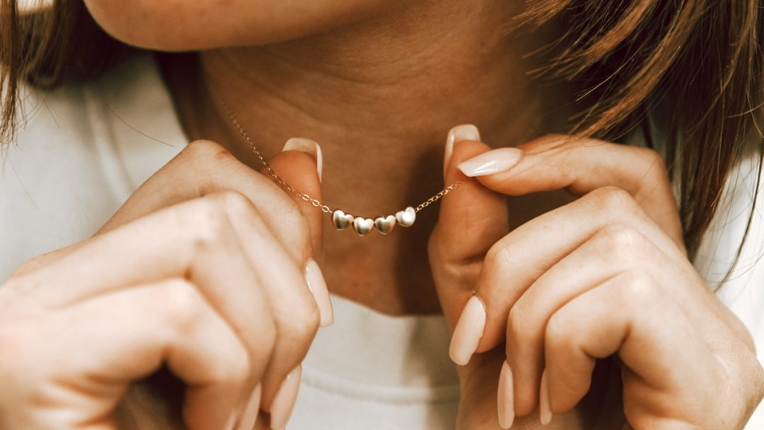 Golden Heart Necklace displayed by a mom as her Valentine's Day Gift